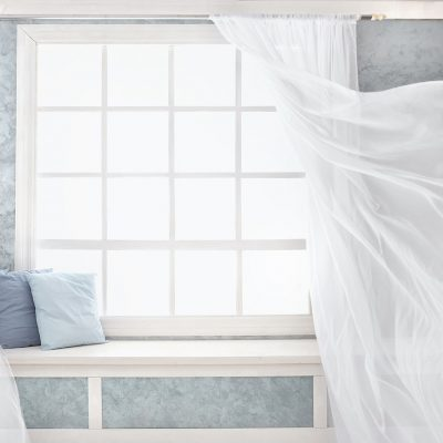 Bright room interior, curtains, white window sill, pillows, plaster.